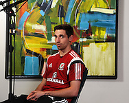 Joe Allen of Wales talks to the media during the Wales football player media session at the St.Davids Hotel in Cardiff Bay , South Wales on Thursday 14th November 2013. pic by Andrew Orchard, Andrew Orchard sports photography,