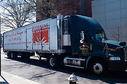 Brooklyn, NY - 15 April 2020. A tractor-trailer from The Food Bank for New York City rolls down Campus Road near Brooklyn College. The food bank is seeing heavier demand for its services as workers are laid off.