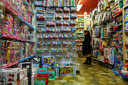 © Licensed to London News Pictures. 13/10/2021. London, UK. A woman looks at the toys in a toy shop in north London. Retailers are warning of toy shortages in the lead up to Christmas, amid fears of ongoing supply chain problems will result in higher prices and empty shelves. Photo credit: Dinendra Haria/LNP