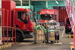 © Licensed to London News Pictures. 20/12/2016. LONDON, UK.  Royal Mail delivery vans and parcels at the East London Mail Centre and Delivery Office. The Communication Workers (CW) Union have called a strike to protest against job losses , the closure of the final salary pension schemes, and selling off of large post office branches to the private sector.  Photo credit: Vickie Flores/LNP