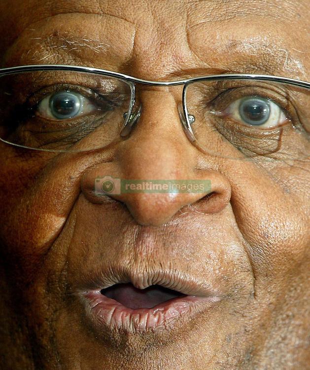Archbishop Desmond Tutu gives a press briefing.