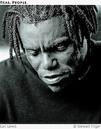 BW portrait of Carl Lewis looking down.