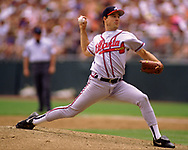 DENVER - 1995:  Greg Maddux of the Atlanta Braves pitches during an MLB game versus the Colorado Rockies at Coors Field in Denver, Colorado during the 1995 season. (Photo by Ron Vesely) Subject:   Greg Maddux