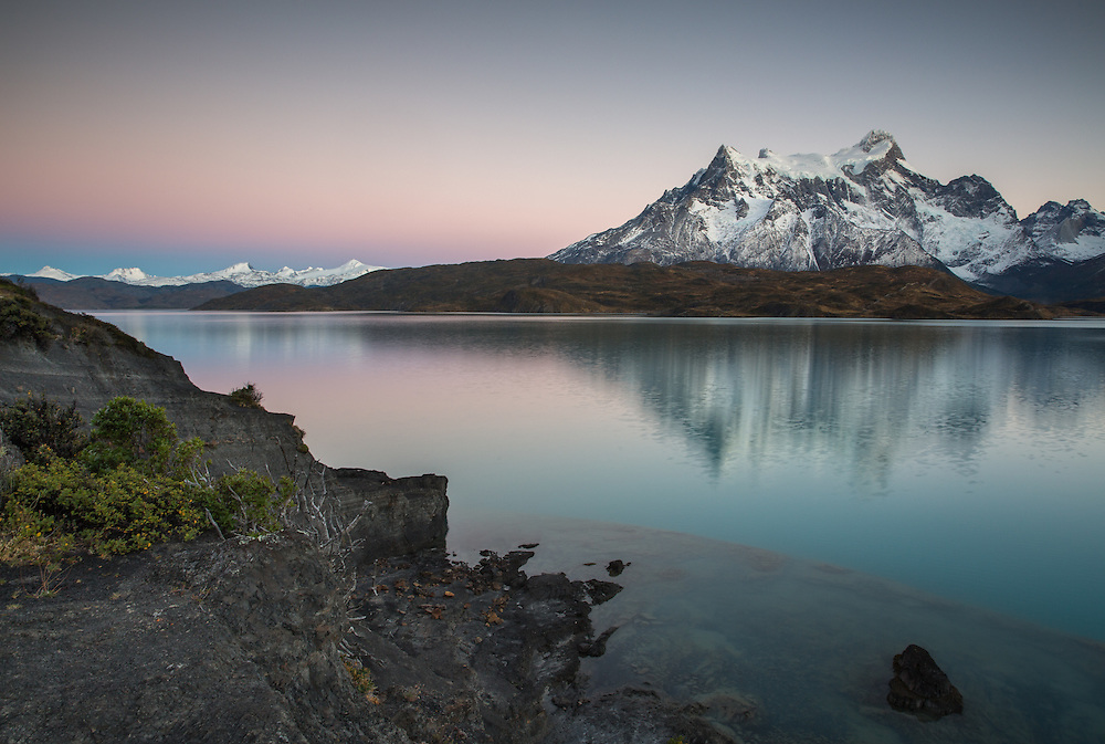 Pehoe Lake appeared magical indeed in the early light of a predawn sky.  Taken at Torres del Paine National Park in Chilean Patagonia.
