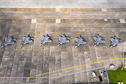 Eight F-22 Raptors from Joint Base Elmendorf-Richardson, Alaska, sit on the flightline, July 9, 2018, at Yokota Air Base, Japan, after being evacuated from Kadena AB, Japan, due to Typhoon Maria. (U.S. Air Force photo by Yasuo Osakabe)