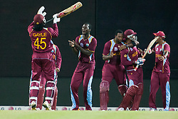 © Licensed to London News Pictures. 01/10/2012. The West Indian team dance & celebrate after winning in the tie breaking super over during the T20 Cricket World super 8's match between New Zealand Vs West Indies at the Pallekele International Stadium Cricket Stadium, Pallekele. Photo credit : Asanka Brendon Ratnayake/LNP