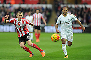 Swansea's Wayne Rutledge (r) chases for the ball watched by Southampton's James Ward-Prowse. Barclays Premier league match, Swansea city v Southampton at the Liberty Stadium in Swansea, South Wales on Saturday 13th February 2016.<br /> pic by  Carl Robertson, Andrew Orchard sports photography.