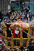 The newly appointed Lord Mayor of the City of London Michael Bear waves to crowds from his carriage during the traditional Lord Mayor's parade through London.