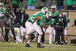 Dec 18, 2020; Huntington, West Virginia, USA; Marshall Thundering Herd running back Brenden Knox (20) runs the ball during the third quarter against the UAB Blazers at Joan C. Edwards Stadium. Mandatory Credit: Ben Queen-USA TODAY Sports