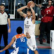 Anadolu Efes's Cenk Akyol (R) during their Turkish Basketball League match Anadolu Efes between Mersin BSB at Sinan Erdem Arena in Istanbul, Turkey, Saturday, January 14, 2012. Photo by TURKPIX