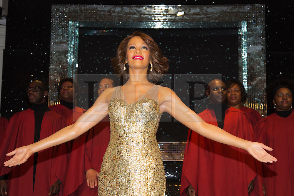 "© Licensed to London News Pictures. 21 October 2013. London, England. The 30-strong ""London Gospel Factory Choir"" today welcomed the wax figure of singer Whitney Houston at Madame Tussauds London, where it will be on display until the middle of December 2013. Photo credit: Bettina Strenske/LNP"