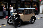 Vintage 1926 Austin Box Saloon car parked outside a pub in London. The Austin Motor Company was a British manufacturer of automobiles. The company was founded in 1905 and merged in 1952 into the British Motor Corporation Ltd. The marque Austin was used until 1987. The trademark is currently owned by SAIC after being transferred from bankrupt subsidiary Nanjing Automotive.
