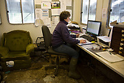 Sally Banks collating data on the herd in the on site office. With a closed herd with no outside influence from other herds off site (apart from the introduction of a bull) the aim is that the cows have one calf per year to keep them milking and to replenish their stocks. To ensure that this provenance as well as each separate element on the farm runs as well and as profitably as possible, all aspects of data are collected and computerised. Wildon Grange Dairy Farm, Coxwold, North Yorkshire, UK. Owned and run by the Banks family, dairy farming here is a scientific business, where nothing is left to chance. From the breeding, nutrition and health of their closed stock of Holstein Friesian cows, through to the end product, the team here work tirelessly, around to clock to ensure content and healthy animals, and excellent quality milk. (photo by Mike Kemp/In Pictures via Getty Images)
