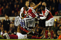 Picture: Henry Browne, Digitalsport<br /> Date: 23/01/2005.<br /> Arsenal v Newcastle United Barclays Premiership.<br /> Lauren starts on Lee Bowyer after a bad challenge.