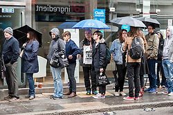 © Licensed to London News Pictures. 16/04/2016. London, UK. Fans queuing in the rain to visit vinyl record shops in and around Berwick Street in Soho today, on Record Store Day, a worldwide celebration of analogue music and music to be listened to from a physical format. Photo credit : Stephen Chung/LNP