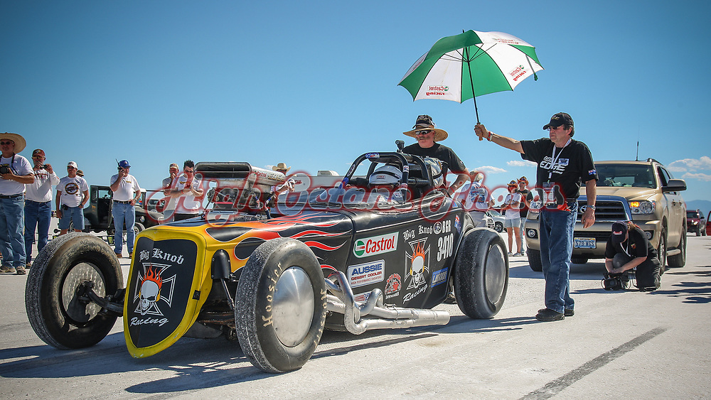 Australian Hot Rodding legend and founder of the Castlemaine Rod Shop, Rod Hadfield, holds an umbrella for Aussie Desert Coolers Norm Hardinge while another Australian Hot Rodding great, Mat Lagoon, looks on.  Shot on the start line at Bonneville for Speedweek 2010.