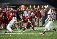 Trinity's Thomas Evans can't take down Laconia's Jake Ellis with the Laconia Sachems taking a commanding lead in the first quarter of Friday night football at Jim Fitzgerald Field.  (Karen Bobotas/for the Laconia Daily Sun)