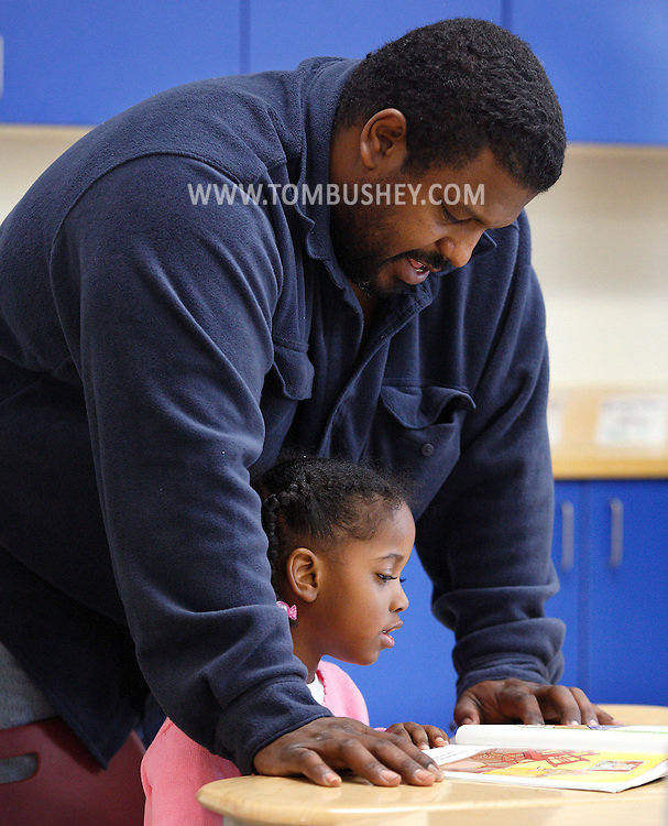 """Mike Horton reads to his daughter Makayla Horton during  """"Join Your Kids at Kindergarten"""" day at Presidential Park Elementary School in Middletown on Monday, Sept. 9, 2013."""