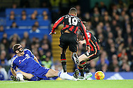 Nemanja Matic of Chelsea tackles Junior Stanislas of Bournemouth. Barclays Premier league match, Chelsea v AFC Bournemouth at Stamford Bridge in London on Saturday 5th December 2015.<br /> pic by John Patrick Fletcher, Andrew Orchard sports photography.