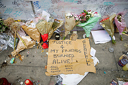 © Licensed to London News Pictures. 01/07/2017. London, UK. Messages and placards left for the victims of the Grenfell Tower fire on Saturday, 1 July 2017 on Latimore Road in west London. Photo credit: Tolga Akmen/LNP