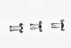 Three mallard ducks swimming up stream in black and white