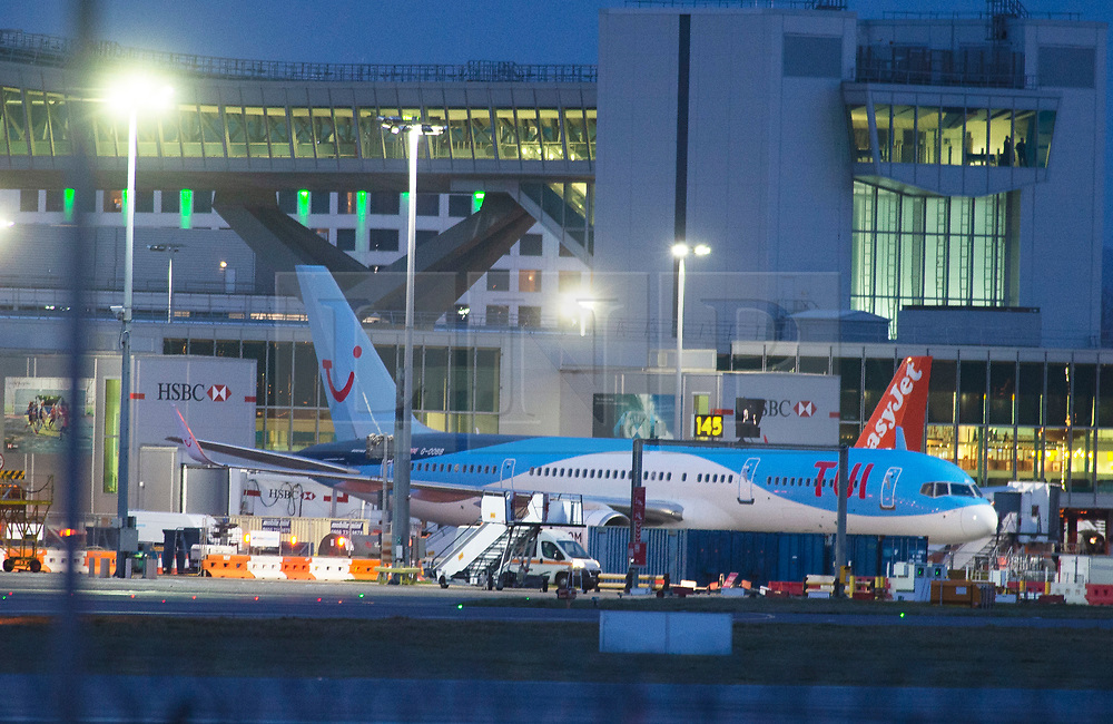 © Licensed to London News Pictures. 20/12/2018. Gatwick, UK. Planes grounded at Gatwick airport as day turns to night. Drone has closed Gatwick airport with all flights in and out cancelled while police hunt for drone pilot deliberately targeting airport.Photo credit: Grant Falvey/LNP