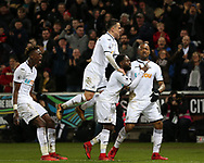 Jordan Ayew of Swansea city ® celebrates with his teammates Roque Mesa (2nd l), Tammy Abraham (l), and Nathan Dyer © after he scores his teams 1st goal to make it 1-1. Premier league match, Swansea city v Crystal Palace at the Liberty Stadium in Swansea, South Wales on Saturday 23rd December 2017.<br /> pic by  Andrew Orchard, Andrew Orchard sports photography.