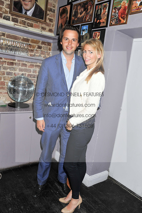 CHARLIE GILKES and ANNEKE VON TROTHA TAYLOR at a party in aid of the Sebastian Hunter Memorial Trust held at Bunga Bunga, 37 Battersea Bridge Road, London SW11 on 21st June 2012.