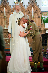 You May Kiss The Bride 1940's Wedding Lytham The Bride Kath Hacking (nee Plummer) and groom Andy Hacking at Saint John The Divine Church Lytham with Reverend Jack Wixon.19 August 2011  Image © Paul David Drabble