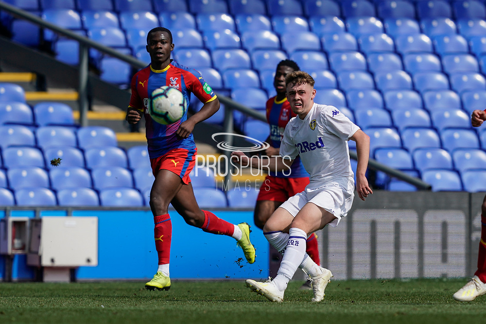 Alfie Mccalmont of Leeds United U23 crosses the ball into the penalty area during the U23 Professional Development League match between U23 Crystal Palace and Leeds United at Selhurst Park, London, England on 15 April 2019.
