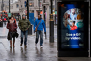 The day after the government introduced a third Coronavirus pandemic national lockdown, effectively a Tier 5 restriction, a National Health Service (NHS) ad urges patients to seek virtual appointments with GP doctors, as the capital experiences a grim post-Christmas and millions of Britons are told to stay at home, on 5th January 2021, in London, England.