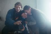 John Knoebber playing with local Uzbekistan boys.