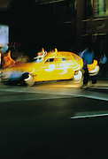 Image of a taxicab in New York City, New York. by Andrea Wells