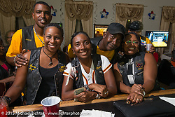 Third Generation Flying Eagles MC siblings Terry Collins and her brother Corey Norris, and Billy D and his sister Marlene Harris at the bar during the club meetup at the American Legion in Catonsville, MD, USA. August 16, 2015.  Photography ©2015 Michael Lichter.