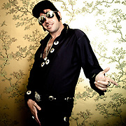 Elvis from a music icons party