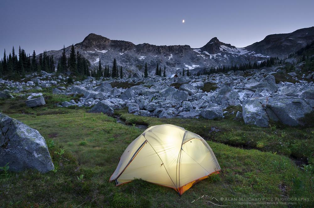Illuminated tent in backcountry camp at dusk, in Marriott Basin near Wendy Thompson Hut, Coast Mountains British Columbia