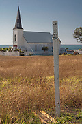 Right at the edge of the Pacific lies this picturesque wooden church. Over the years, the surrounding erodes away but the church seems to stay pretty much the same. Here is the same church in the year 2000: http://zeaside.kiwi/gallery-image/Raukokore-01/G0000JQdfqFlkXXQ/I0000oMyv8UaQ3hA/C0000TWUvjgToWeQ