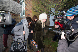 ©  London News Pictures.  20/12/2013. London, UK. Italian Sisters Elisabetta (left in grey jacket) and Francesca (centre in black) Grillo, who are the former personal assistants to Charles Saatchi and Nigella Lawson, arriving at Isleworth Crown Court in London surrounded by media.  A jury is currently considering a verdict in the Gillo sisters trial for misappropriating funds while working for Saatchi and Lawson. Photo credit : Ben Cawthra/LNP
