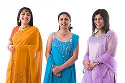 Three women wearing traditional Asian dress,