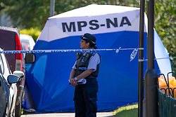 © Licensed to London News Pictures.<br /> 30/07/2020.  London, UK. A young man in aged in his mid-20 has been shot dead on a street in Edmonton, north London. Met Police say at 9:00pm yesterday, they were called to Beaconsfield Road. The victim was pronounced dead at the scene shortly after 10pm. The gunman remains at large - so far no arrests have been made.Photo credit: Marcin Nowak/LNP