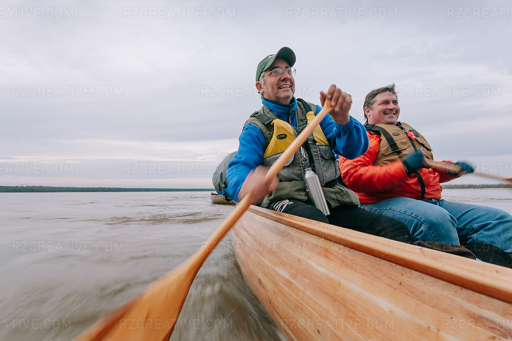 Tim Richardson (left) and Kevin Smith (right) paddle a canoe on the lower Mississippi River. Photo © Robert Zaleski / rzcreative.com<br /> —<br /> To license this image for editorial or commercial use, please contact Robert@rzcreative.com