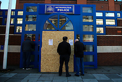 © Licensed to London News Pictures. 12/11/2020. London, UK. Members of public outside at the entrance to Edmonton Police Station in north London which is boarded up following an incident where a vehicle was driven into the police station just before 7pm on Wednesday, 11 November. A 45-year-old man left the vehicle before attempting to set fire to it using petrol. He was arrested by officers on suspicion of arson and is remanded in custody. The incident is not being treated as terror-related. Photo credit: Dinendra Haria/LNP