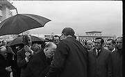 Archbishop Ryan Returns From Rome..1972..16.02.1972..02.16.1972..16th February 1972..After his official appointment as Archbishop of Dublin by Pope Paul VI, Dr Dermot Ryan returned to Dublin for his installation as Archbishop on Feb 22nd at the Pro Cathedral,Dublin..Image of The President,Eamon DeValera,as he braves the weather to greet Dr Dermot Ryan on his arrival at Dublin Airport..Picture of a proud Dr Dermot Ryan,Dublins new Archbishop, as he descends from the aircraft at Dublin Airport..
