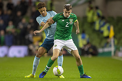 November 15, 2018 - Dublin, Ireland - Seamus Coleman of Ireland fights for the ball with Jamal Lewis of N.Ireland during the International Friendly match between Republic of Ireland and Northern Ireland at Aviva Stadium in Dublin, Ireland on November 15, 2018  (Credit Image: © Andrew Surma/NurPhoto via ZUMA Press)