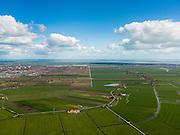 Nederland, Noord-Holland, Gemeente Waterland, 16-04-2012; zicht op polder De Purmer met links onder het midden De Nes (met afwijkende verkaveling). Midden links de bebouwing van Purmerend met Purmerbos, de wijk Purmer-Noord en bedrijventerrein De Baanstee. Rechts Edam-Volendam..Polder the Purmer with its circular canal (Purmerringvaart ), left the village of Purmerend. In the back the Markermeer (lake)..luchtfoto (toeslag), aerial photo (additional fee required);.copyright foto/photo Siebe Swart