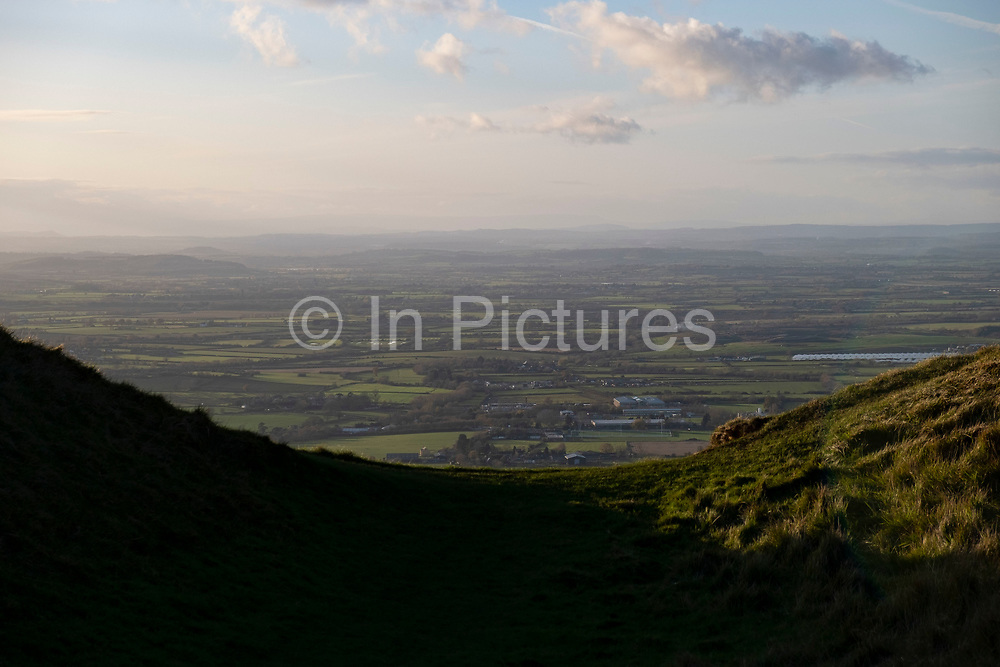 Views across Gloucestershire from Cleve Hill on 22nd November 2020 in Cheltenham, United Kingdom. Cleeve Hill is the highest point both of the Cotswolds hill range and of the county of Gloucestershire, at 1,083 feet. It is located on Cleeve Common which is a Site of Special Scientific Interest looked after by a small charity called Cleeve Common Trust.