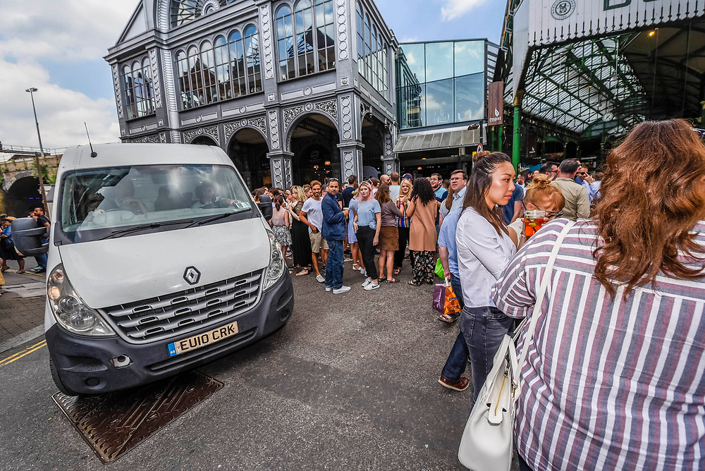 Stoney street is soon thronging with lunchtime eaters and drinkers and even vans return without any fuss - The market reopening is signified by the ringing of the bell and is attended by Mayor Sadiq Khan. Tourists and locals soon flood back to bring the area back to life.London  14 June 2017.