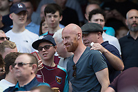 Football - 2017 / 2018 Premier League - Arsenal vs. West Ham United<br /> <br /> Fans favourite James Collins (West Ham United) takes his seat in the stands with the fans to watch his team at The Emirates.<br /> <br /> COLORSPORT/DANIEL BEARHAM