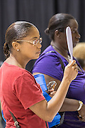 A patient tests free eye glasses during a medical mission held by the SC Dental Association on August 23, 2013 in North Charleston, South Carolina. More than 1,000 people showed up to receive free dental and medical care.