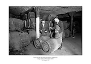 Testing ten-year-old whiskey at Jameson's underground storage facility at Bow Street, Dublin.<br /> <br /> 30th August 1963<br /> <br /> 30.08.1963